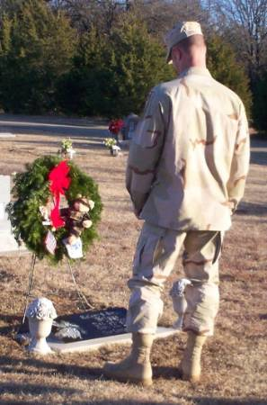 Kelsey's dad standing over his daughter's grave.