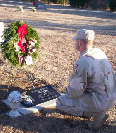 Kelsey's dad at her grave.